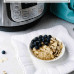 blueberry almond oatmeal in white bowl