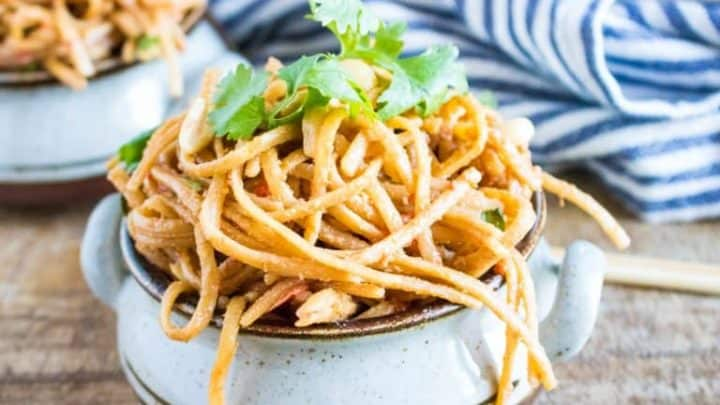 Thai Noodles in a bowl with a blue and white striped towel in the background