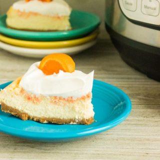 orange creamsicle cheesecake on blue plate
