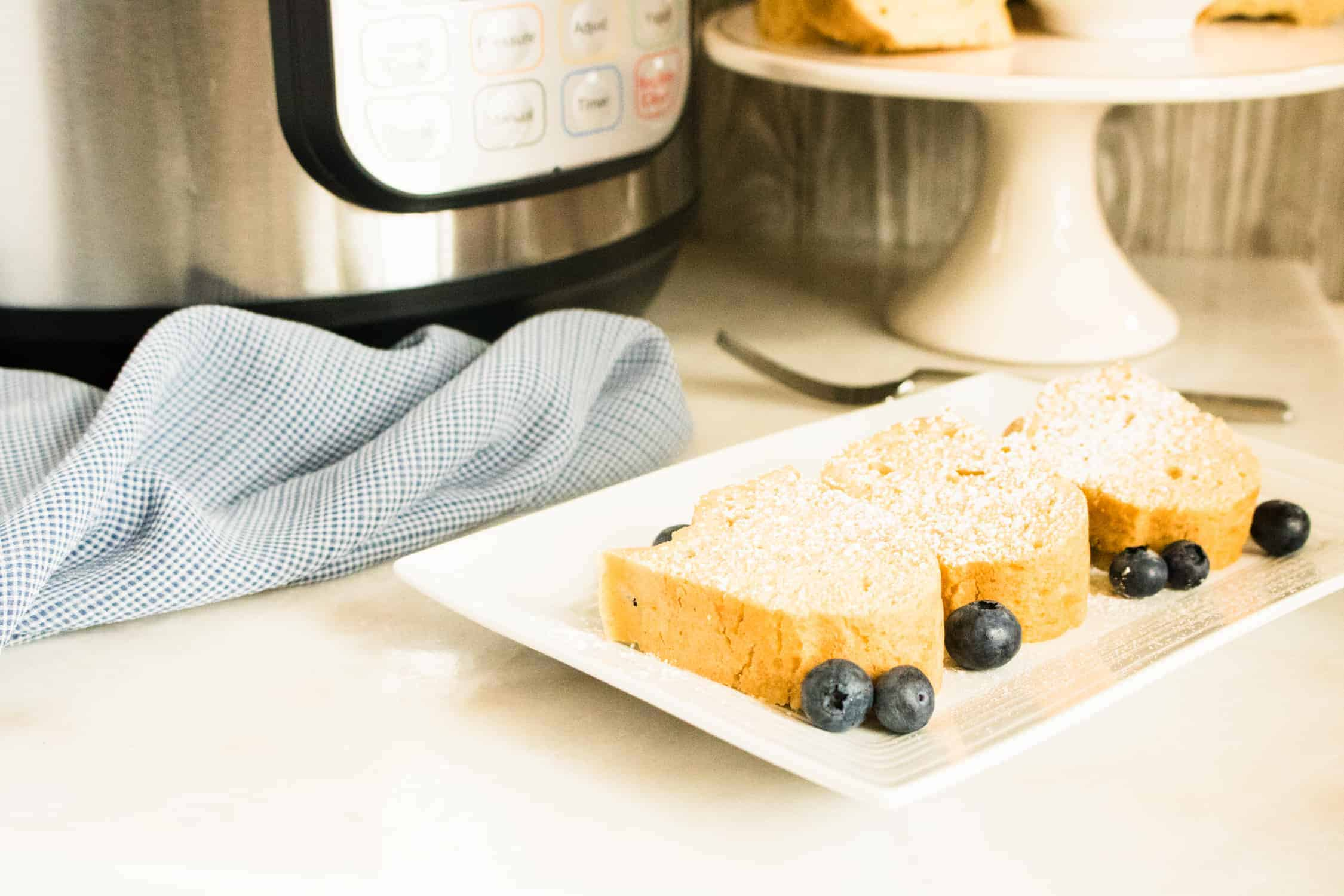 instant pot pound cake slices on white plate