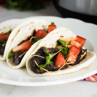 black bean soft tacos on white plate