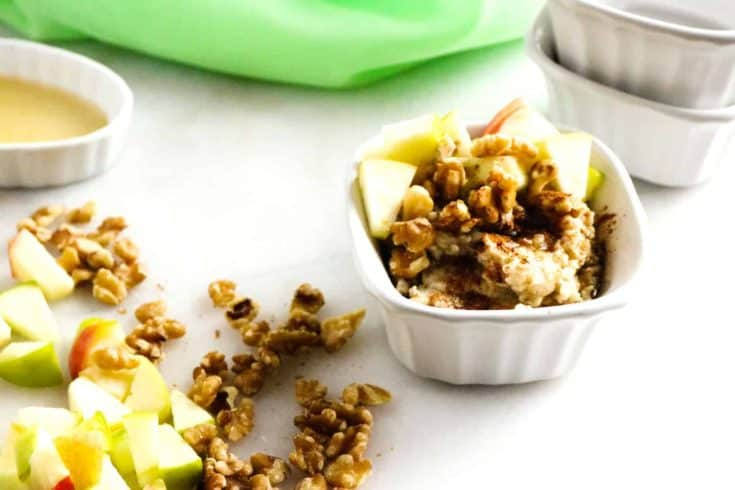 apple and walnut oatmeal in white bowl