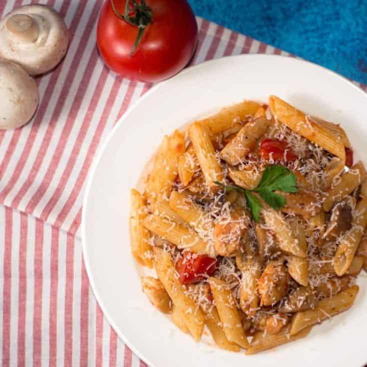 chicken pasta on white plate
