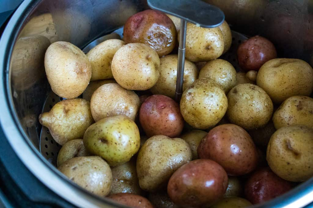 Add in the potatoes and roast them