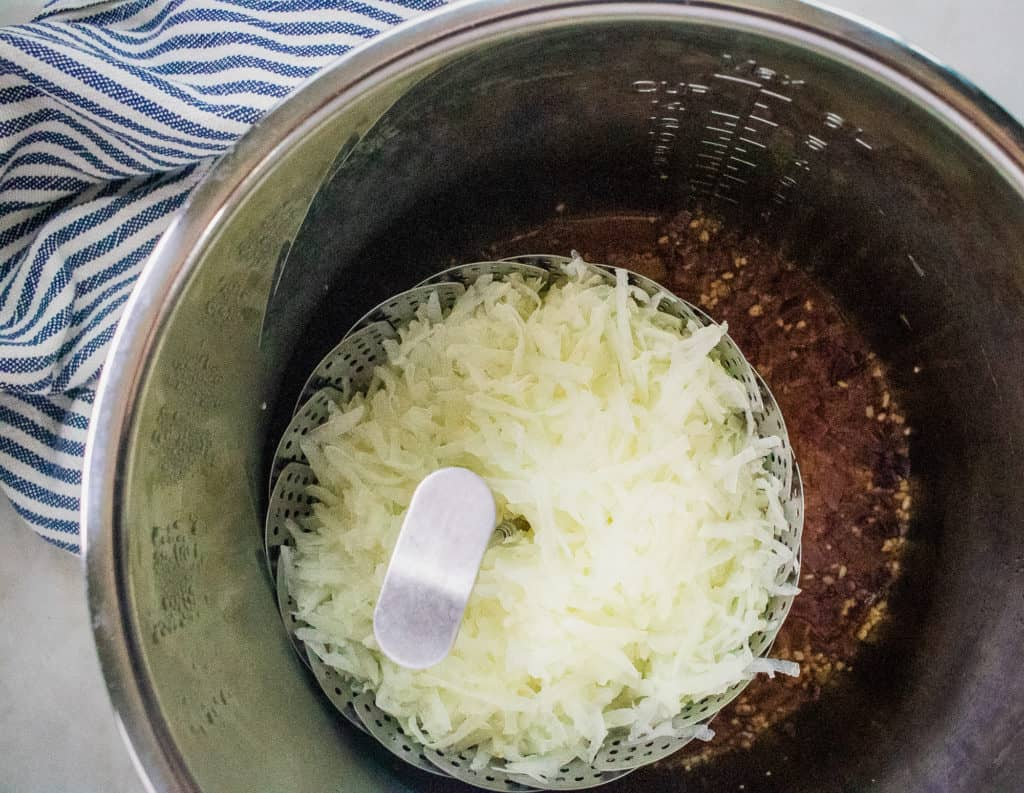 Add shredded potatoes to an Instant Pot