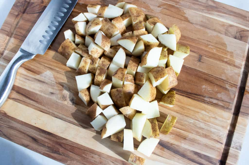 diced potatoes on cutting board for instant pot goulash