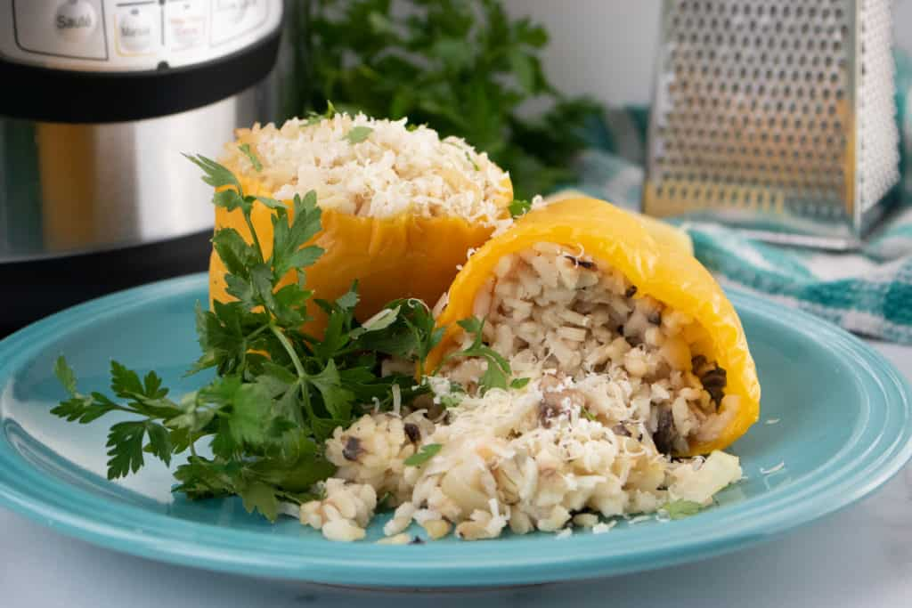 Instant Pot Risotto Stuffed Peppers are flavorful bell peppers full of Parmesan and Mushroom Risotto.