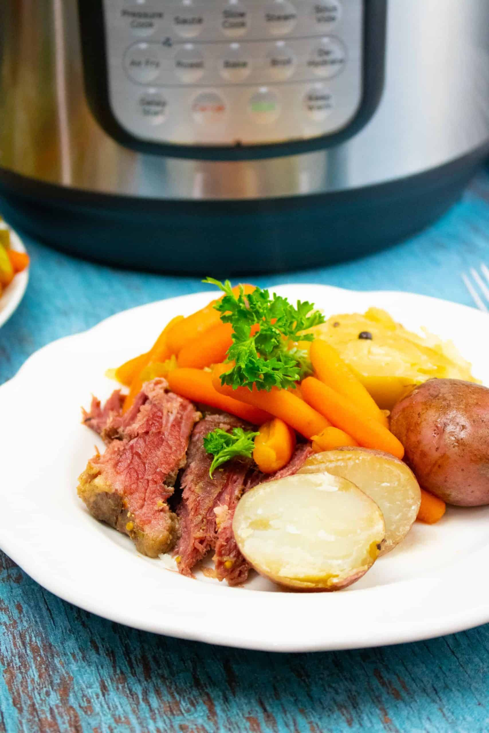 corned beef and carrots and potatoes on white plate