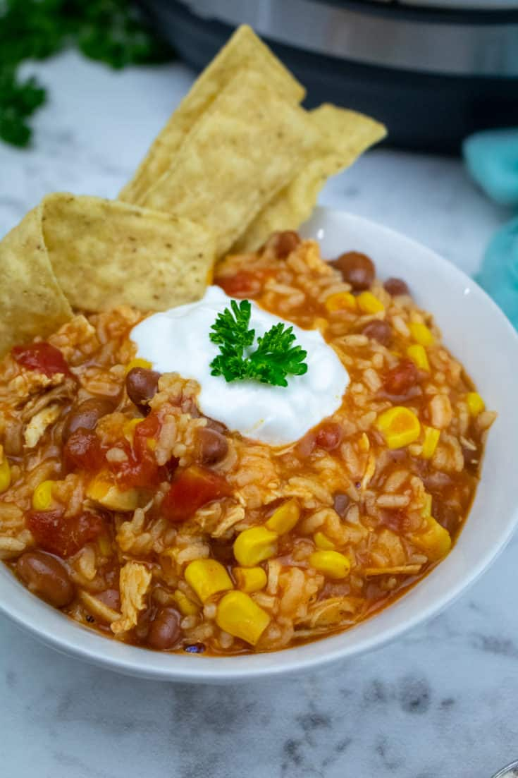 enchilada casserole in white bowl