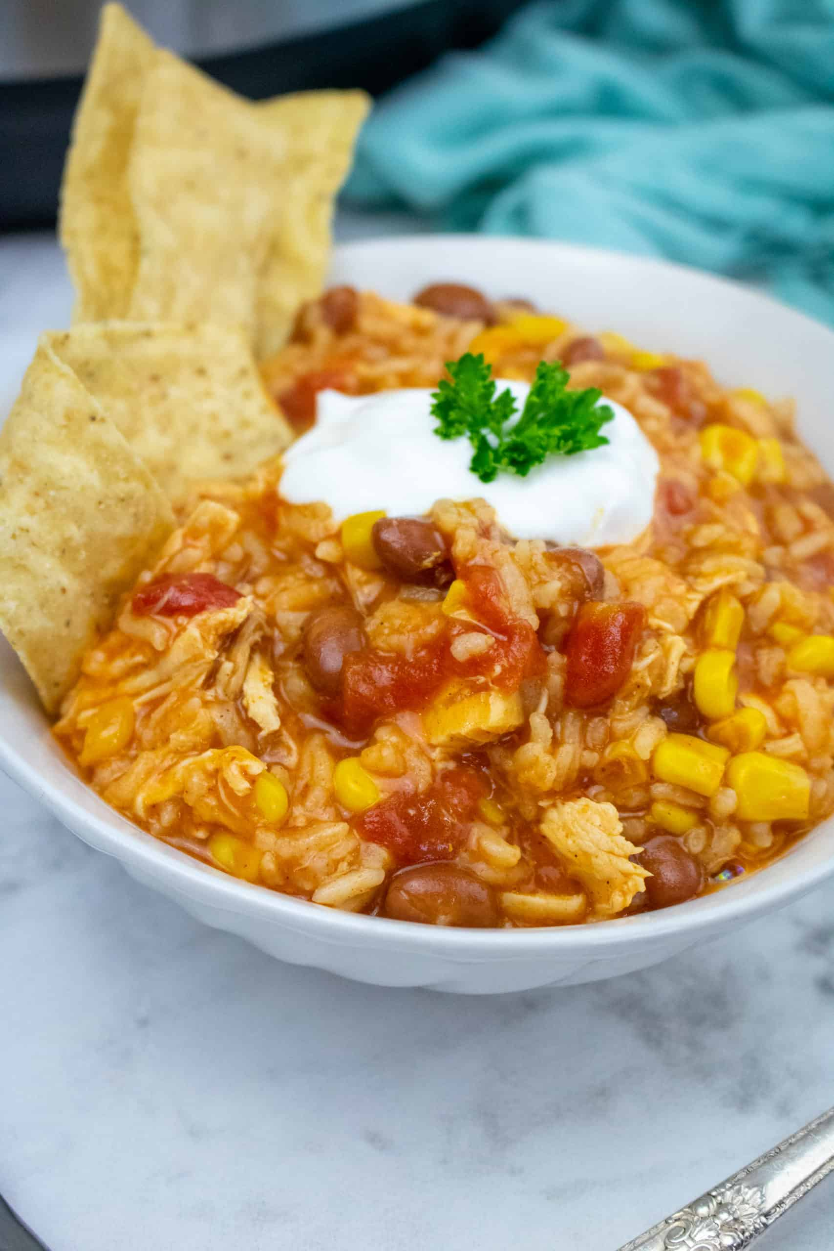 Instant Pot Chicken Enchilada Casserole with rice is the ultimate Instant Pot chicken recipe. You have tender rice, corn, black beans, shreds of chicken in every single bite.