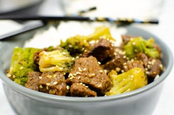 beef and broccoli in grey bowl
