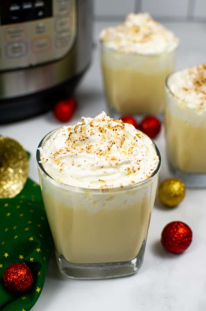 Instant Pot Eggnog in cups with whipped cream topping