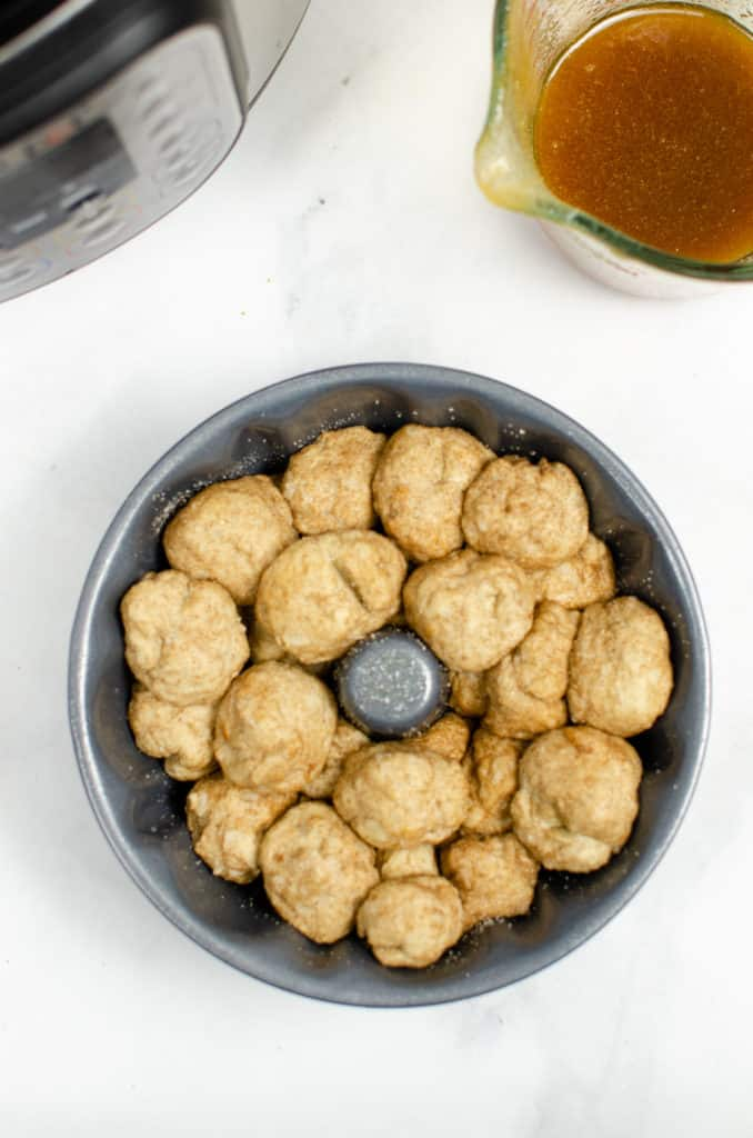Instant Pot Monkey Bread ingredients in pan