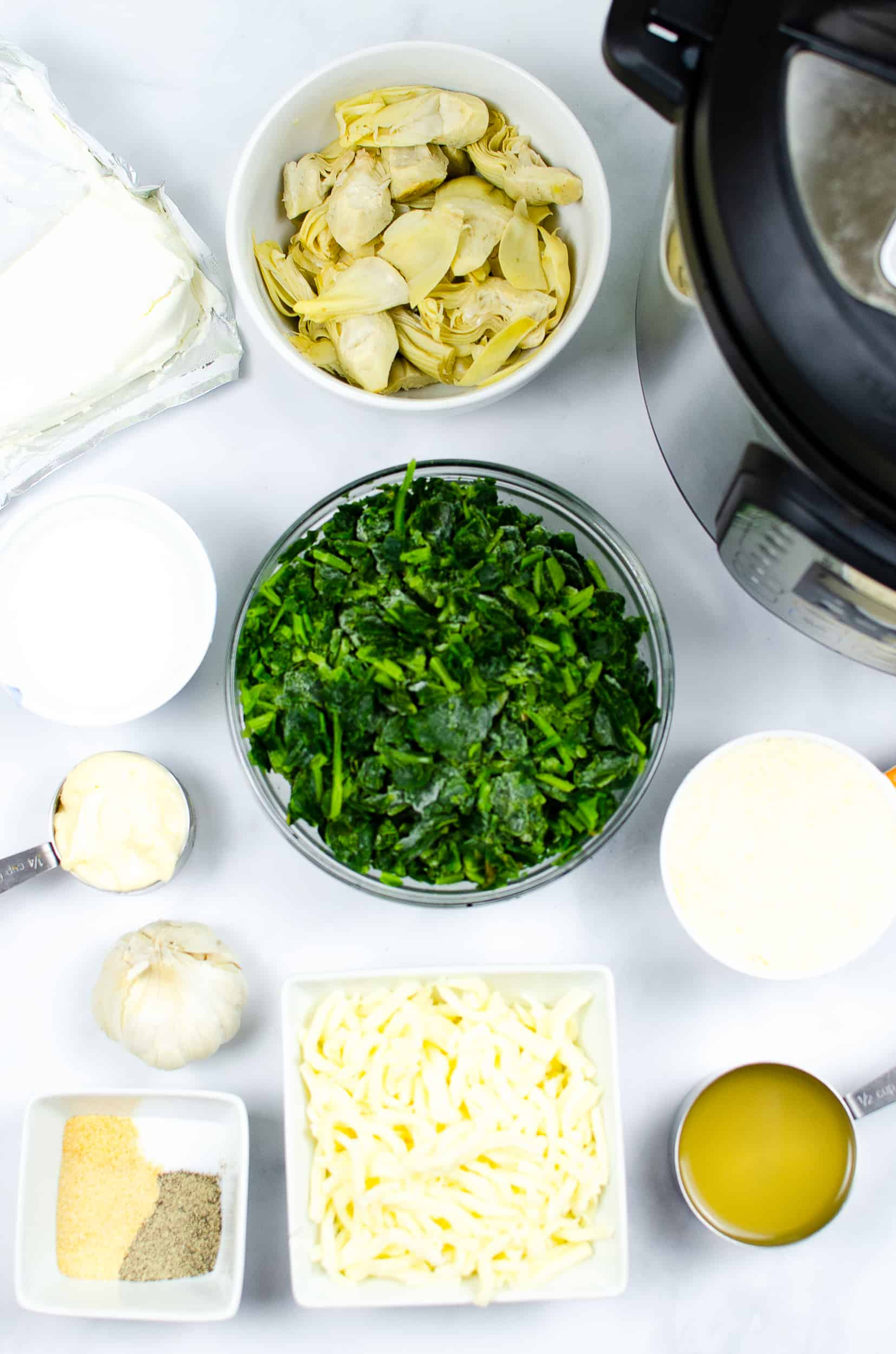 olive garden spinach artichoke ingredients on white counter
