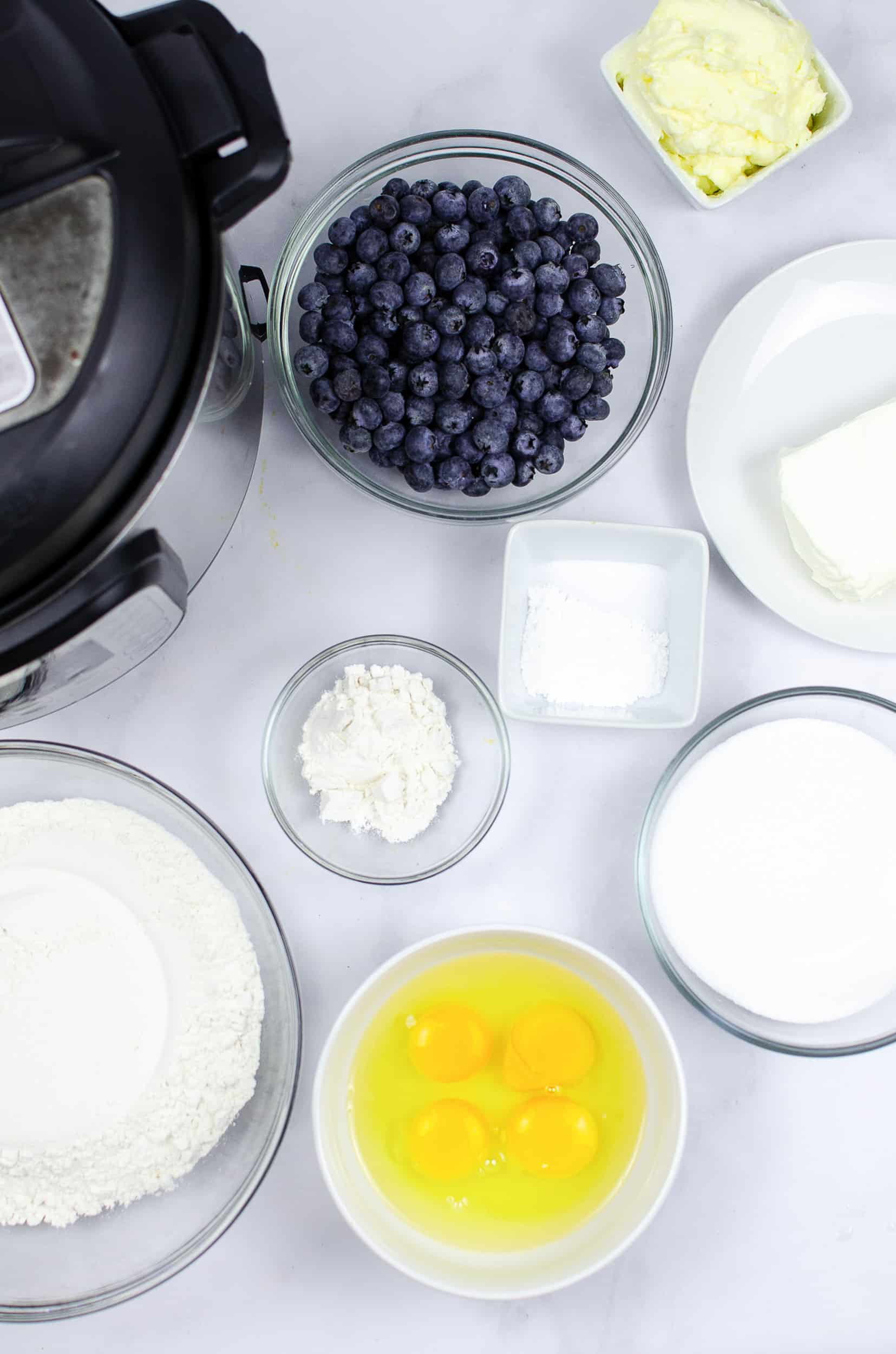 blueberry muffin cake recipe ingredients in clear bowls