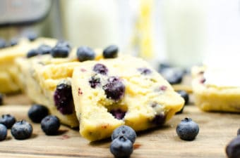 blueberry muffin cake recipe sliced on wooden cutting board