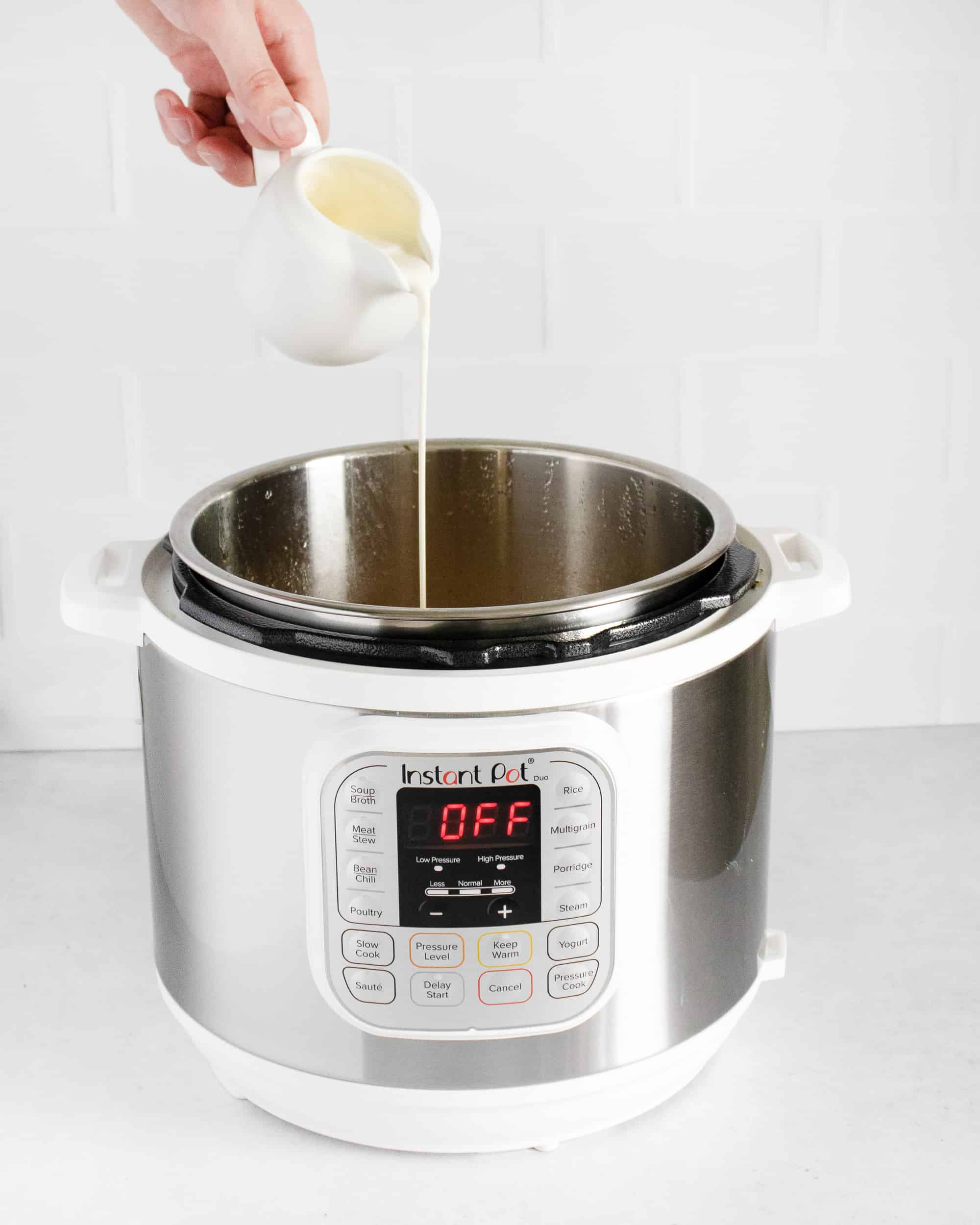 adding cream to Instant Pot Butternut Squash Soup in Instant Pot