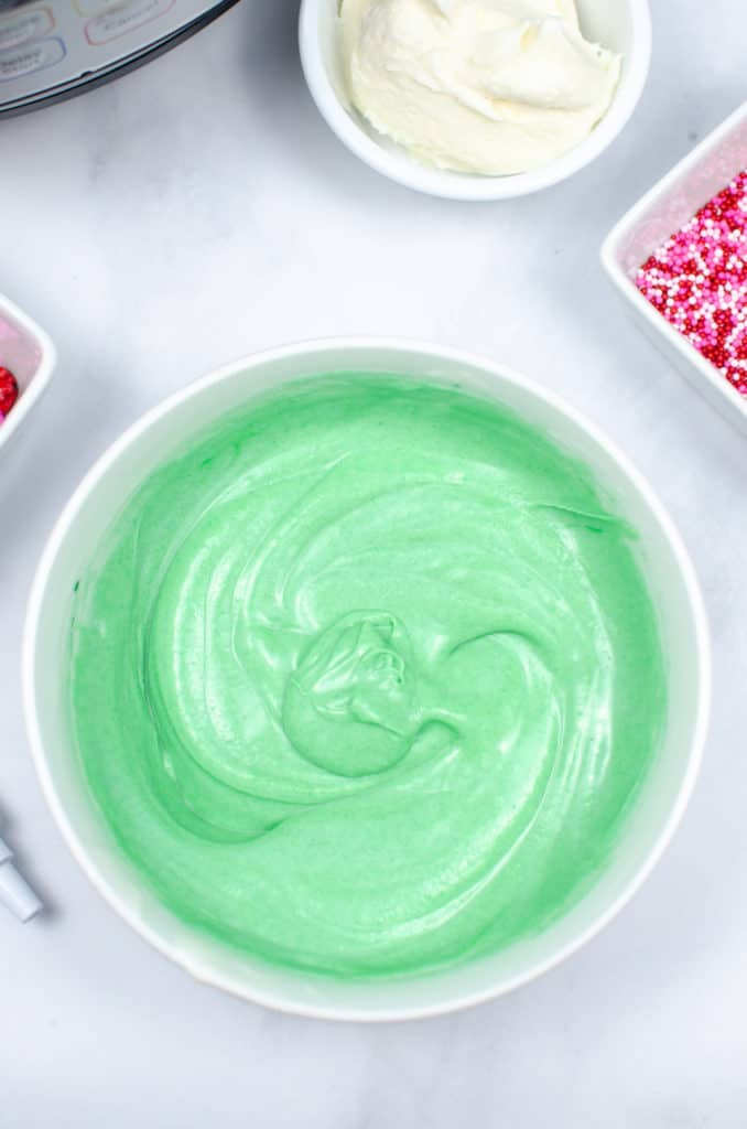 green melted white chocolate for cake pops christmas truffles in white bowl