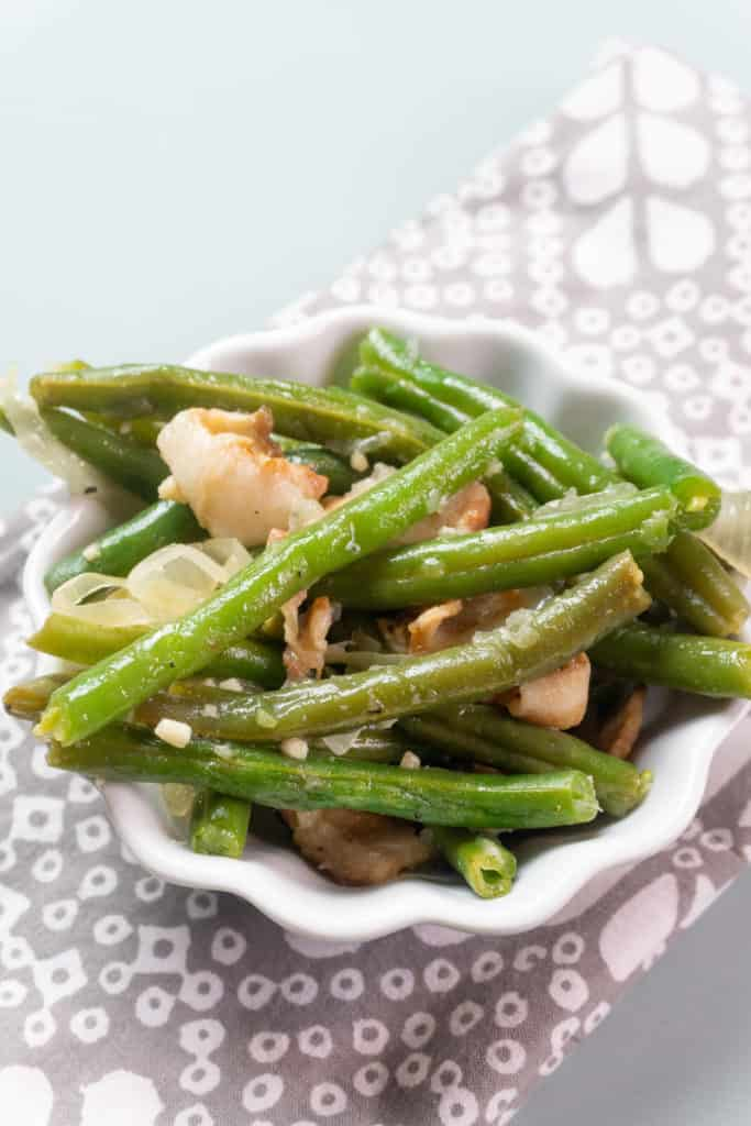 green beans with bacon in white bowl