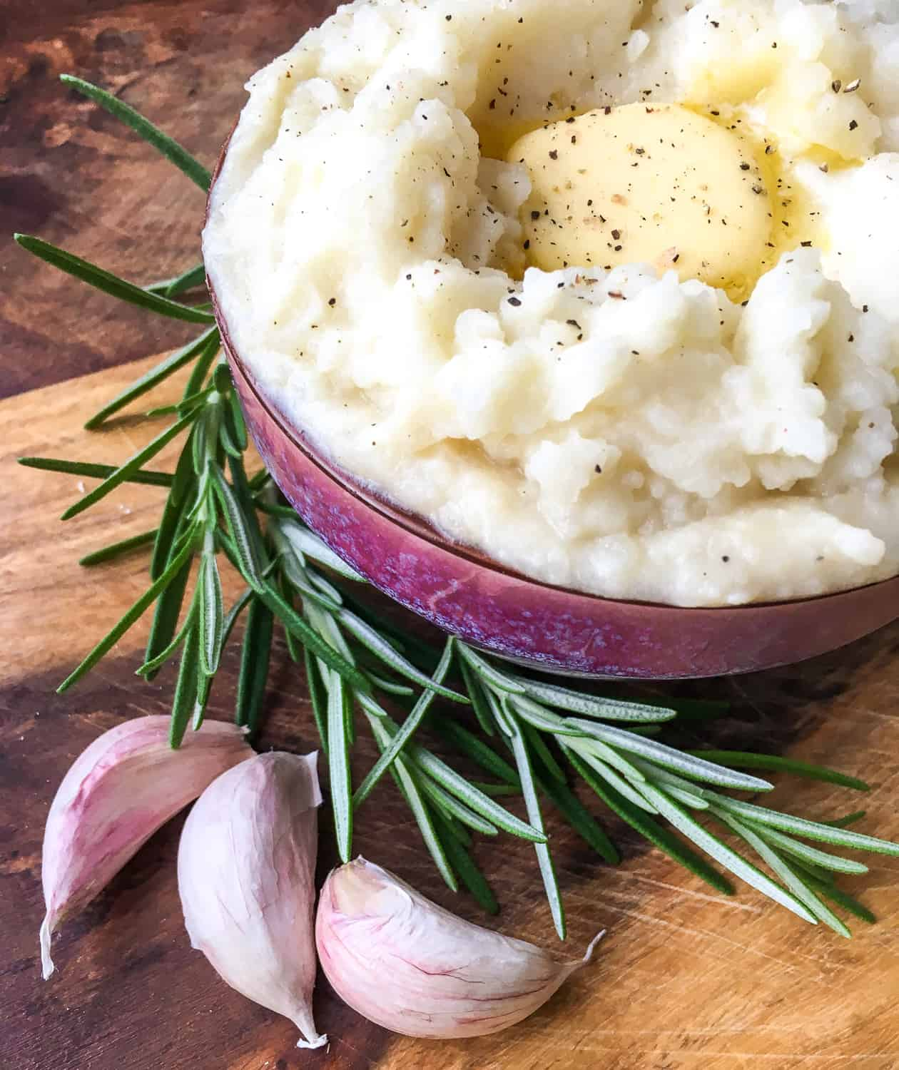 creamy potatoes in bowl with a dab of butter