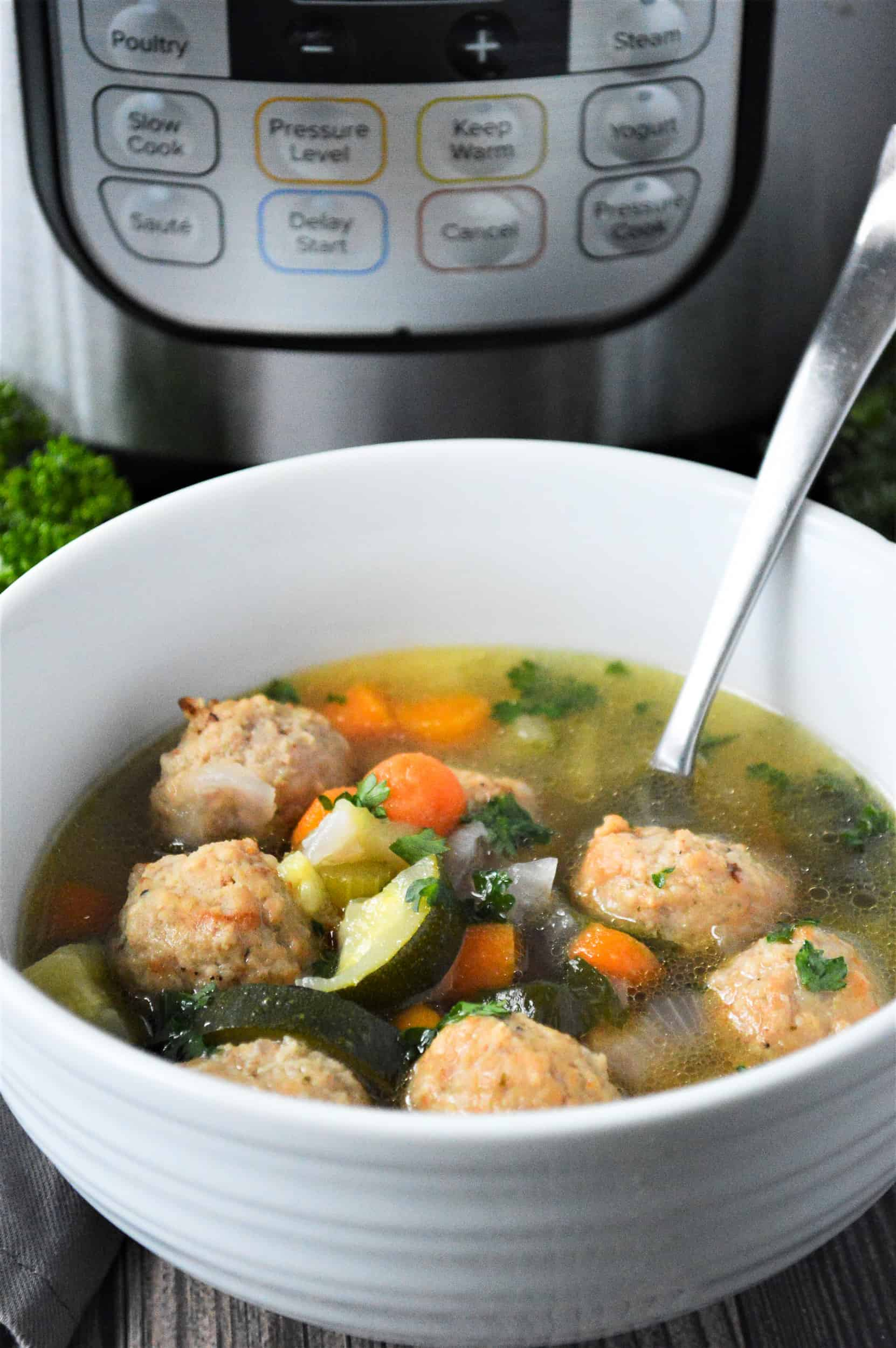white bowl with meatball soup