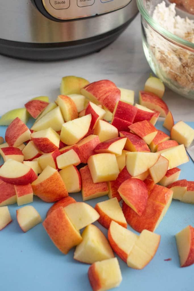 instant pot apple crisp apples cut up on cutting board for apple crisp