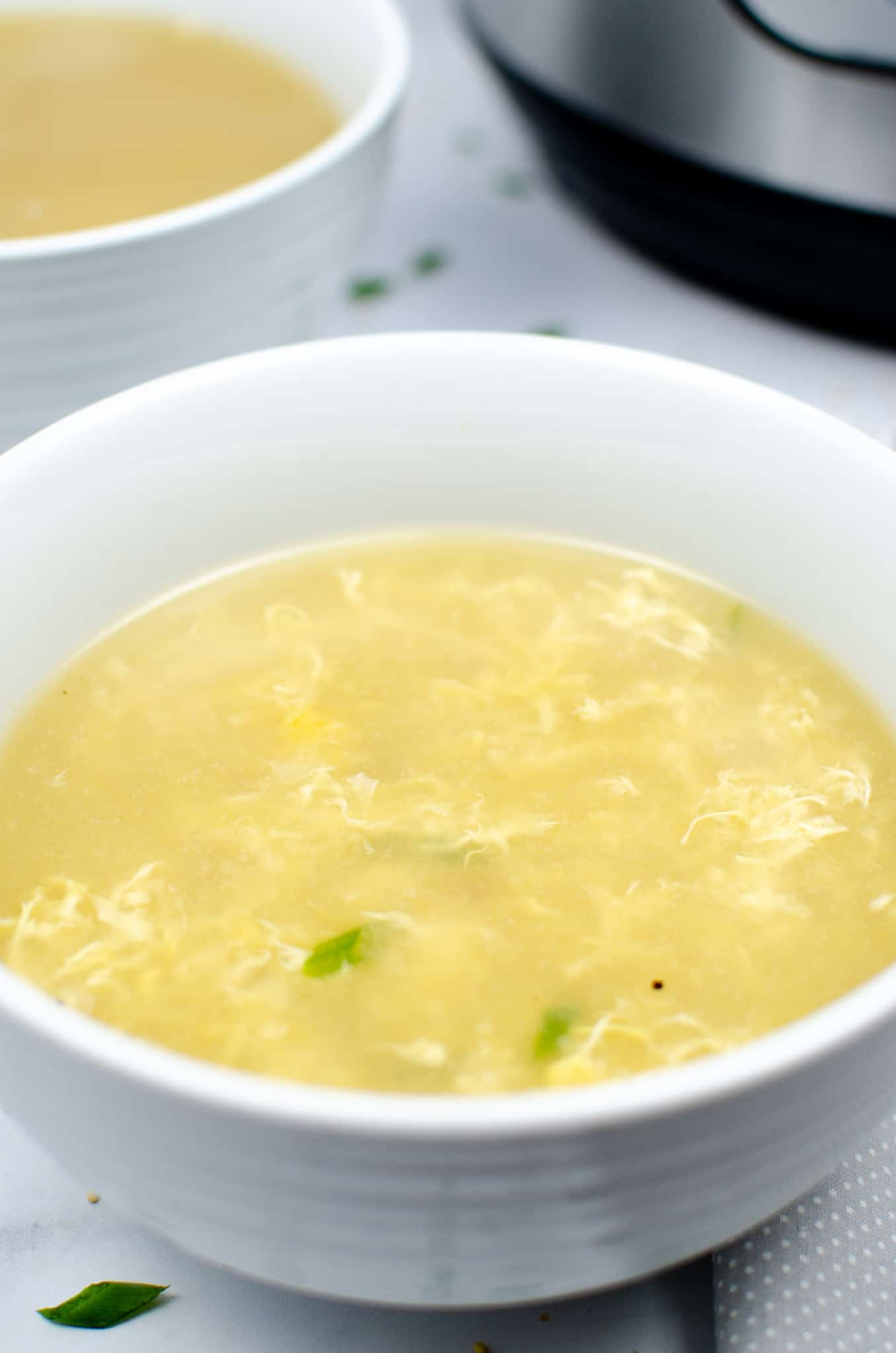 Instant Pot keto egg drop soup in white bowl