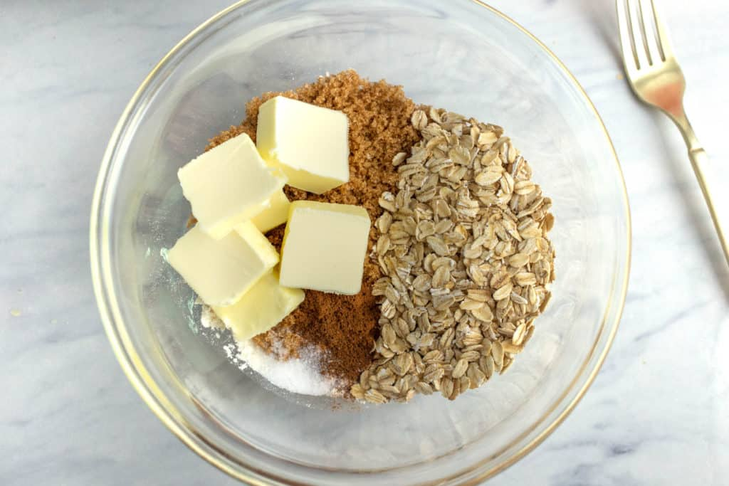instant pot apple crisp topping ingredients in clear mixing bowl