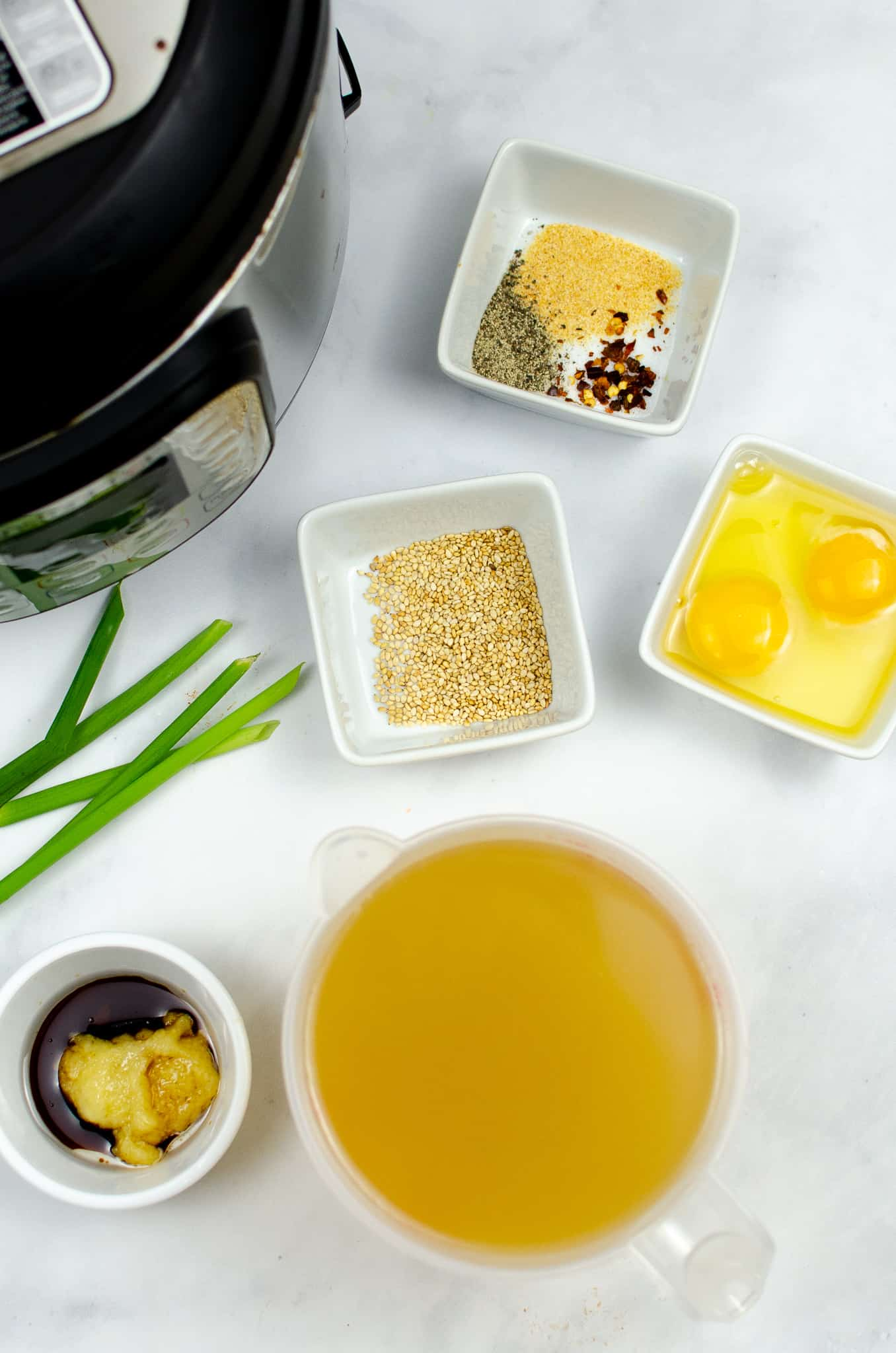 ingredients for Instant Pot keto egg drop soup in ingredient bowls on white background