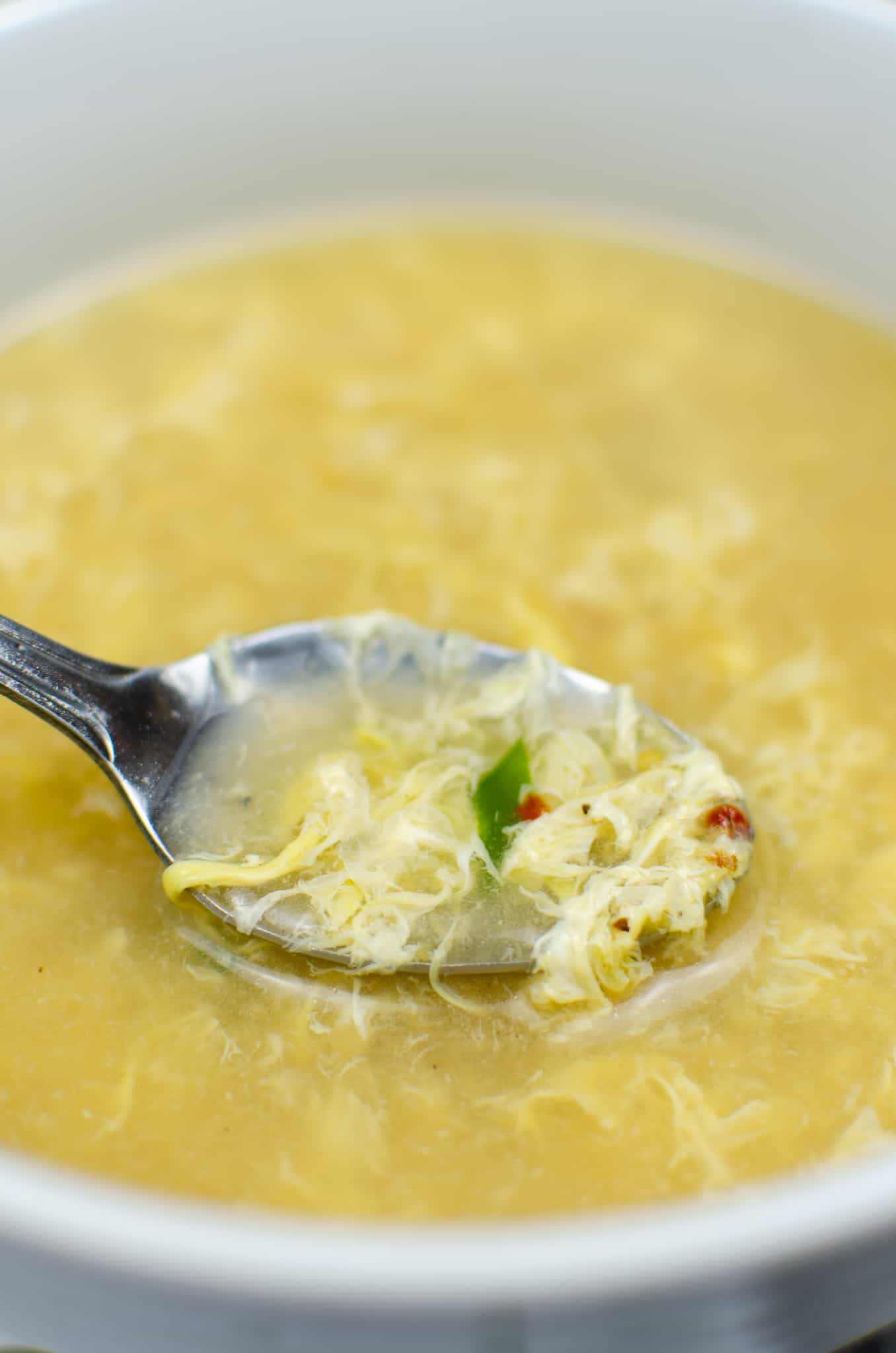 spoonful of Instant Pot keto egg drop soup in white bowl