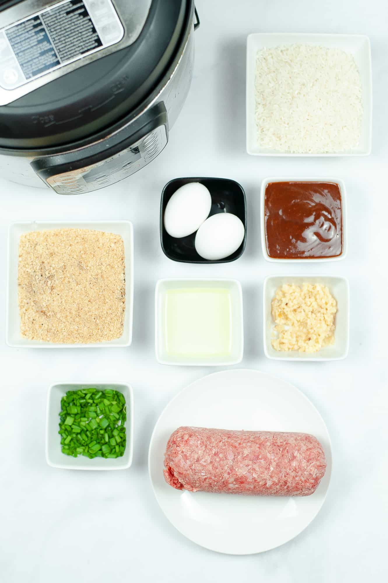 asian meatball ingredients in ingredient bowls on counter