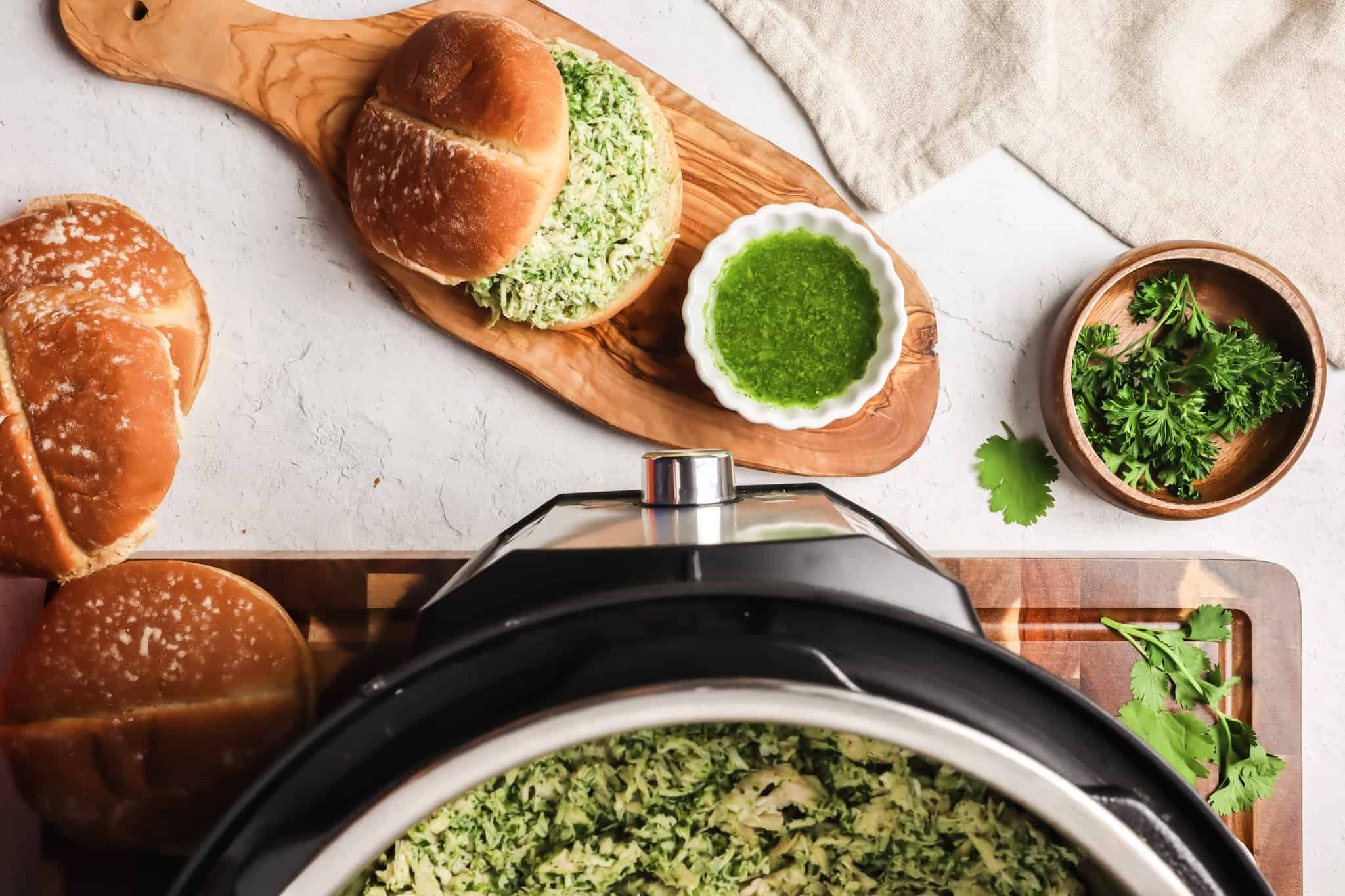 chicken chimichurri in instant pot, on a sandwich and in a white bowl