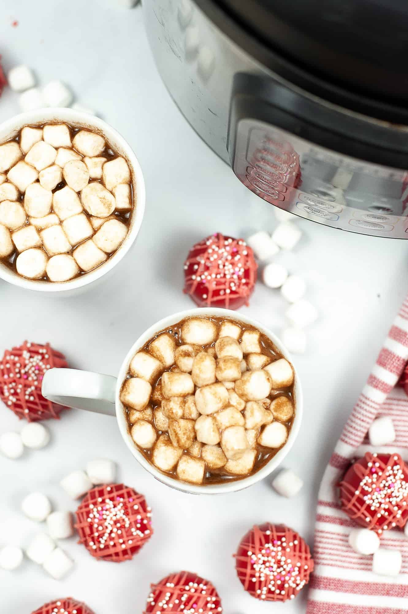 two mugs of cocoa with mini marshmallows