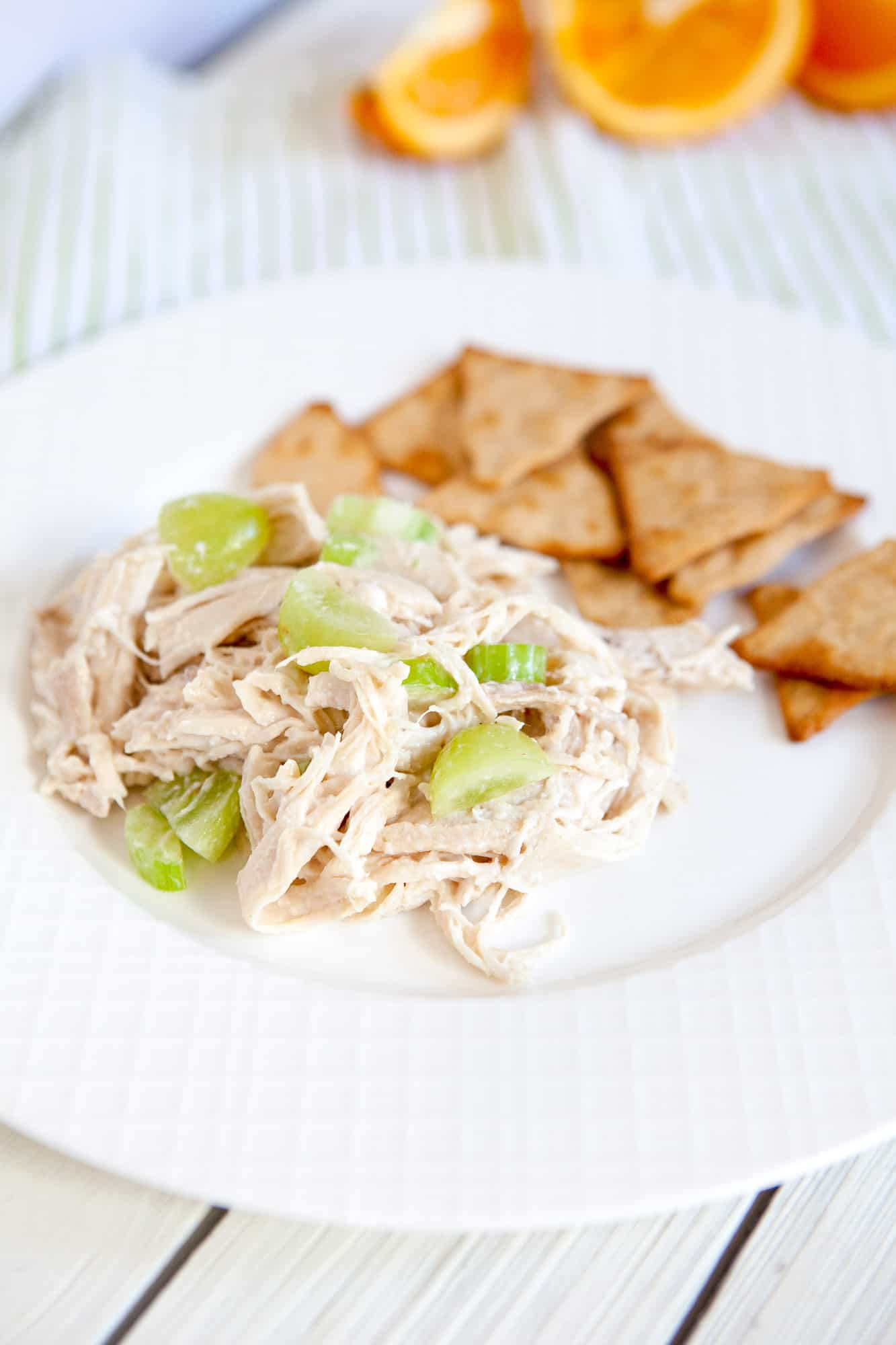chicken salad with crackers on white plate