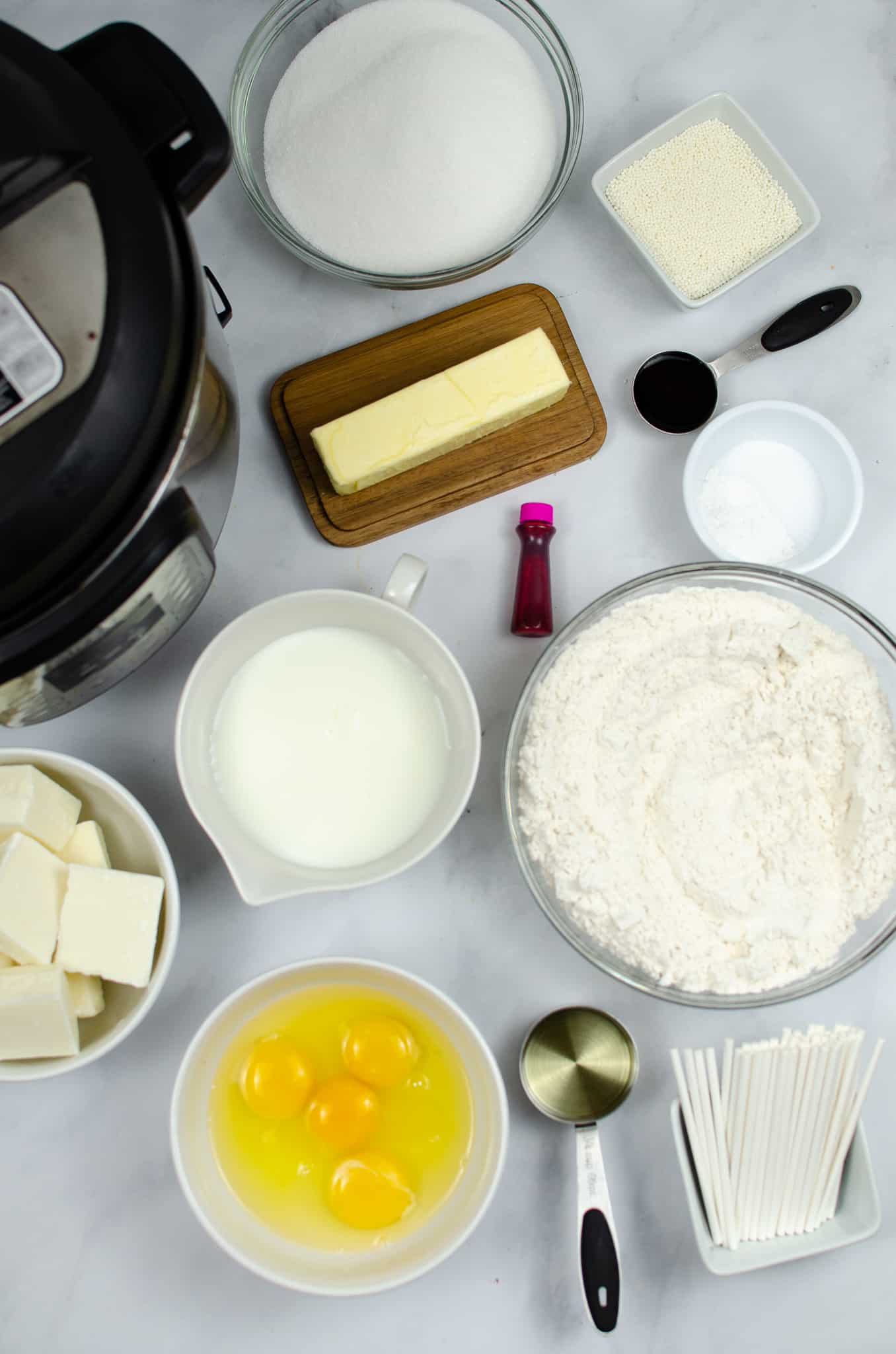 ingredients for cakepops in ingredient bowls on countertop