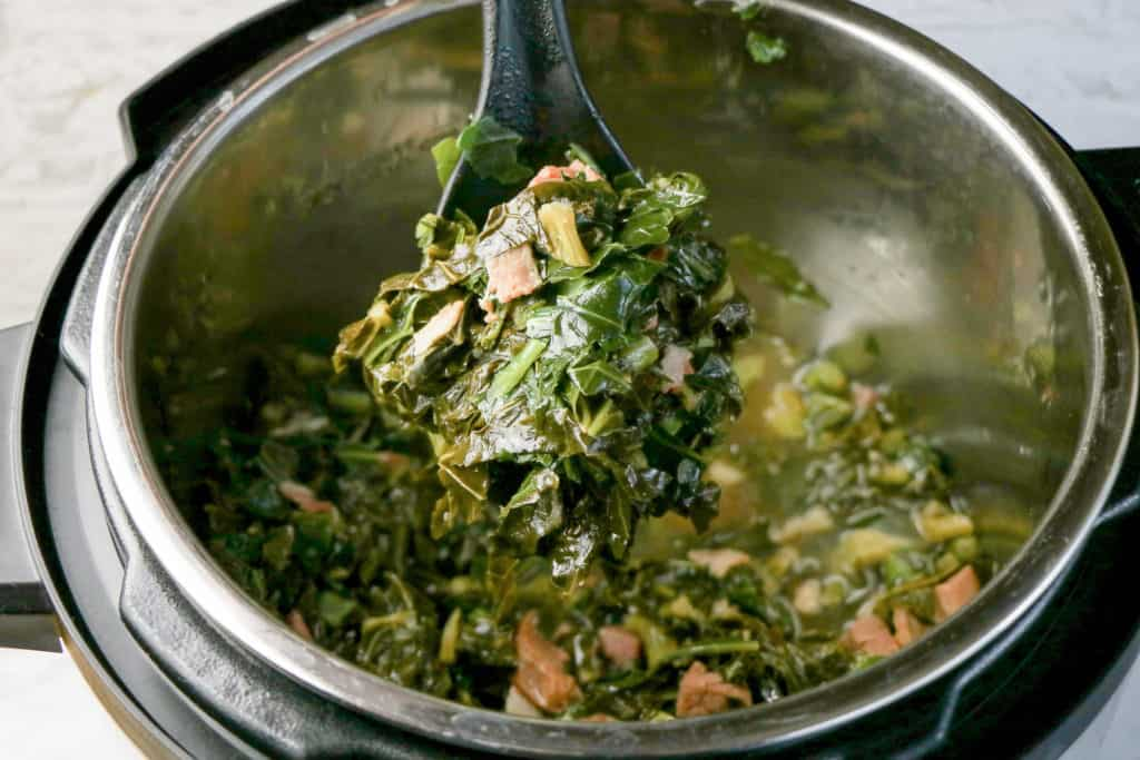 cooked southern collard greens with ham and bacon in instant pot