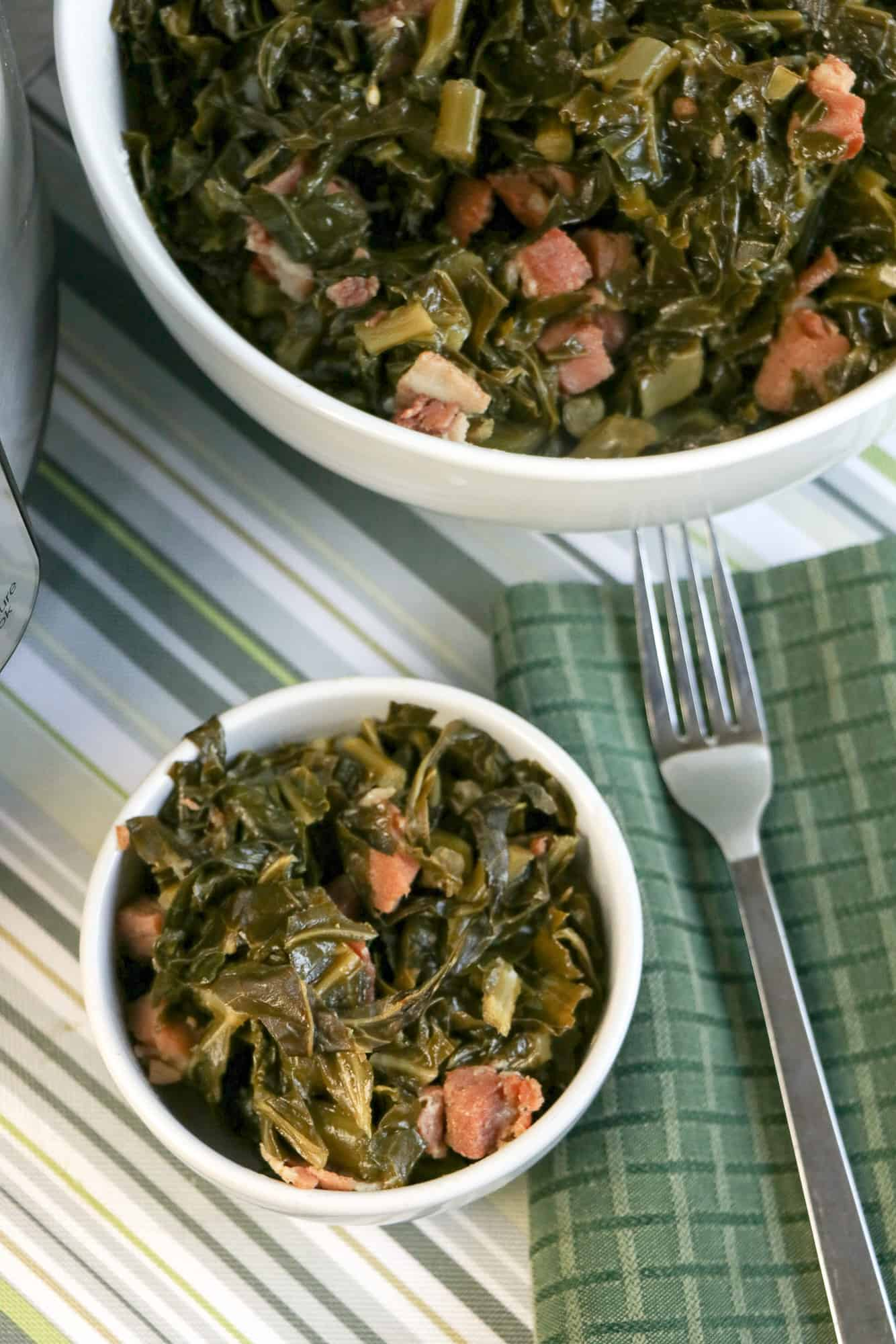southern collard greens with ham and bacon in white bowls