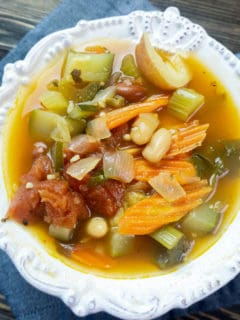 vegetarian minestrone soup in white bowl