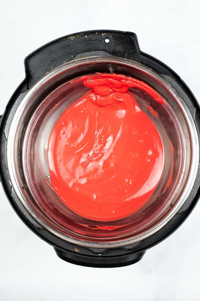 melted red candy melts in double boiler