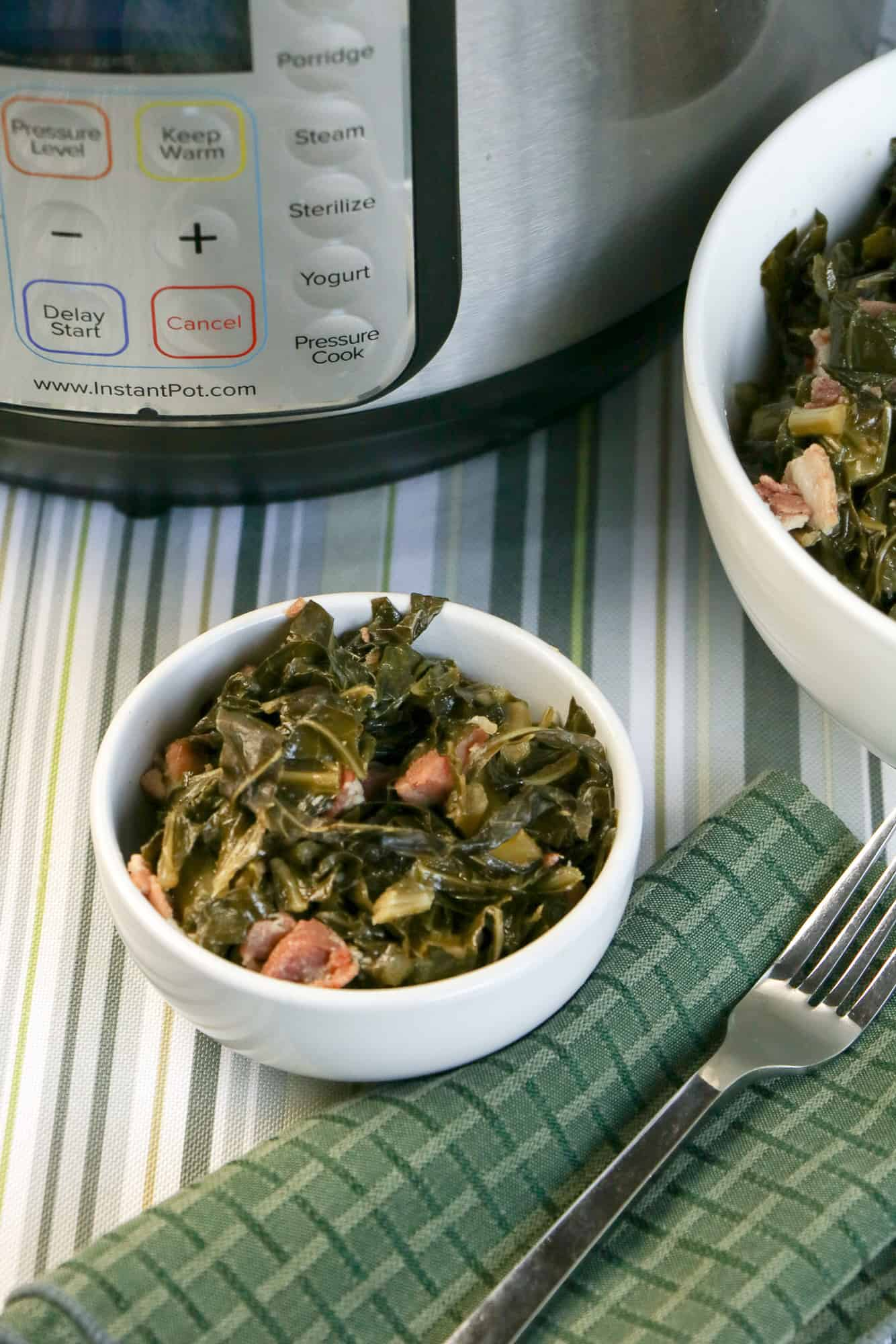 instant pot collard greens with ham and bacon in white bowls