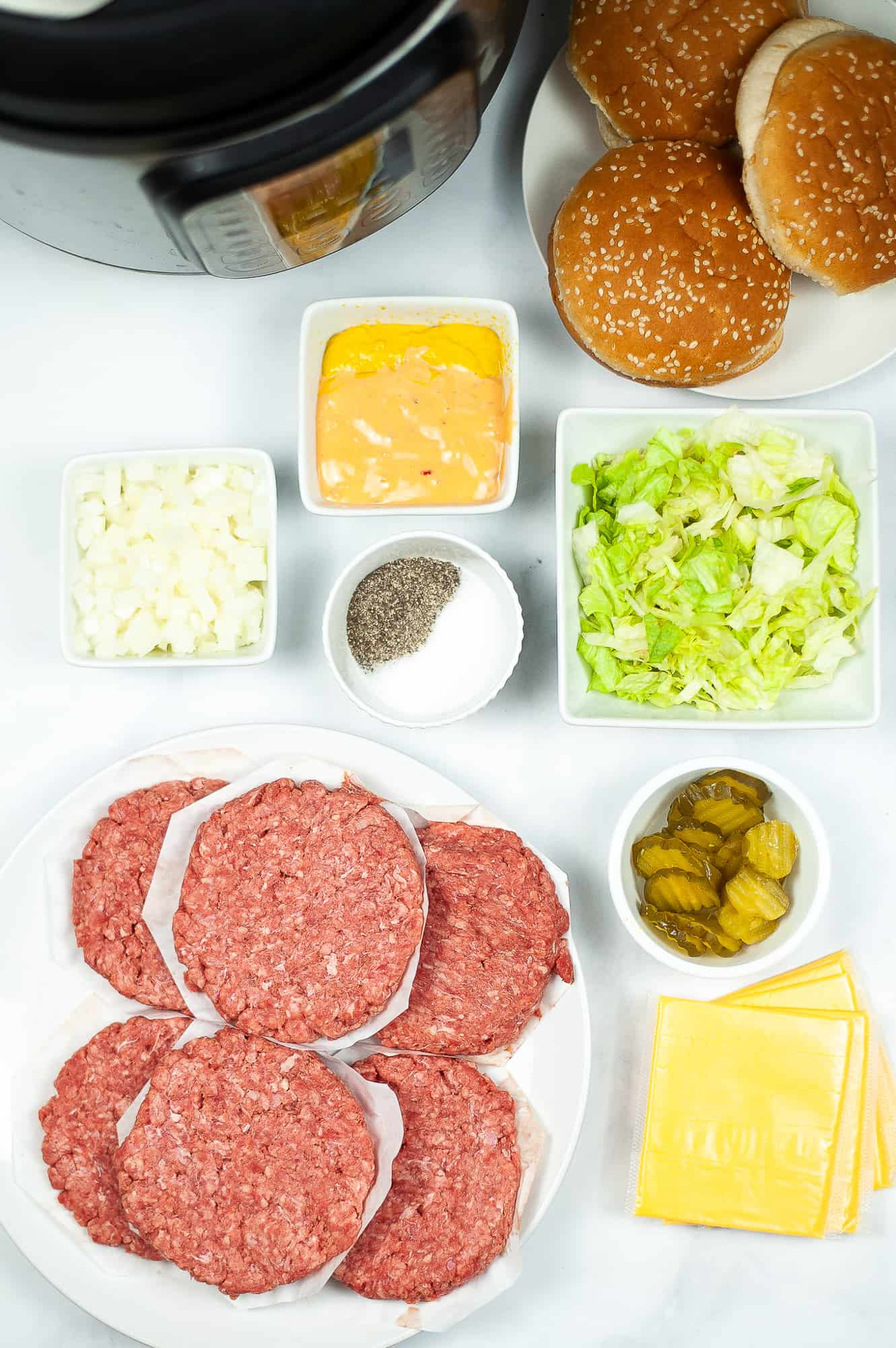 ingredients for homemade big macs on counter in ingredient bowls