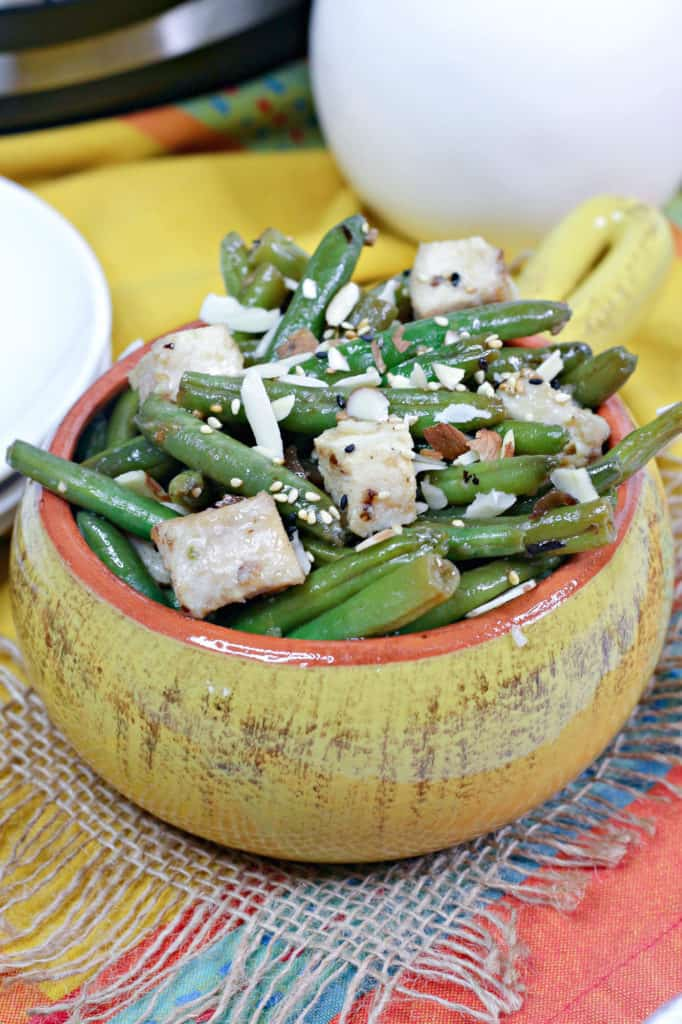 green beans and chicken in yellow bowl