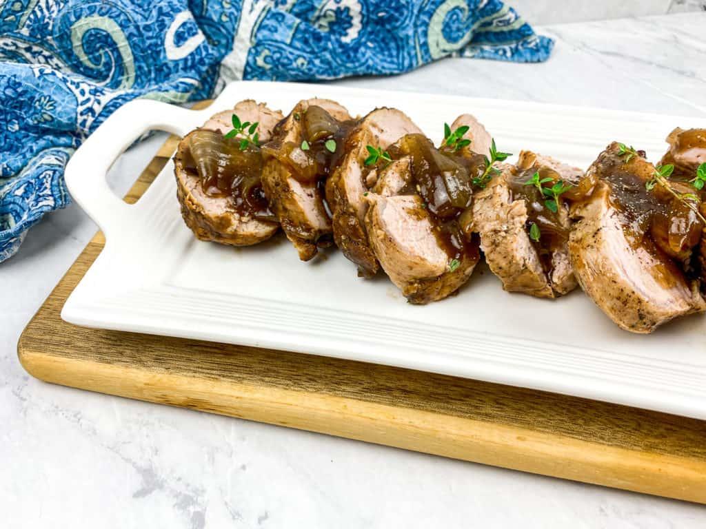 balsamic pork loin on white platter