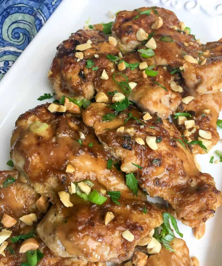 thigh chicken on white plate