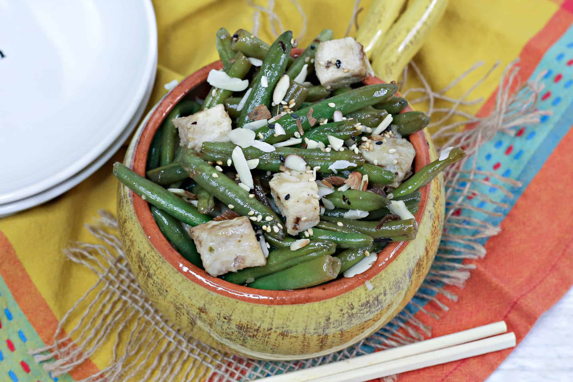 chicken and green beans in yellow bowl