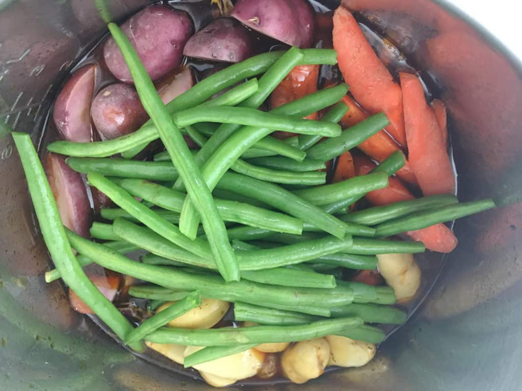 green beans and root vegetables in instant pot