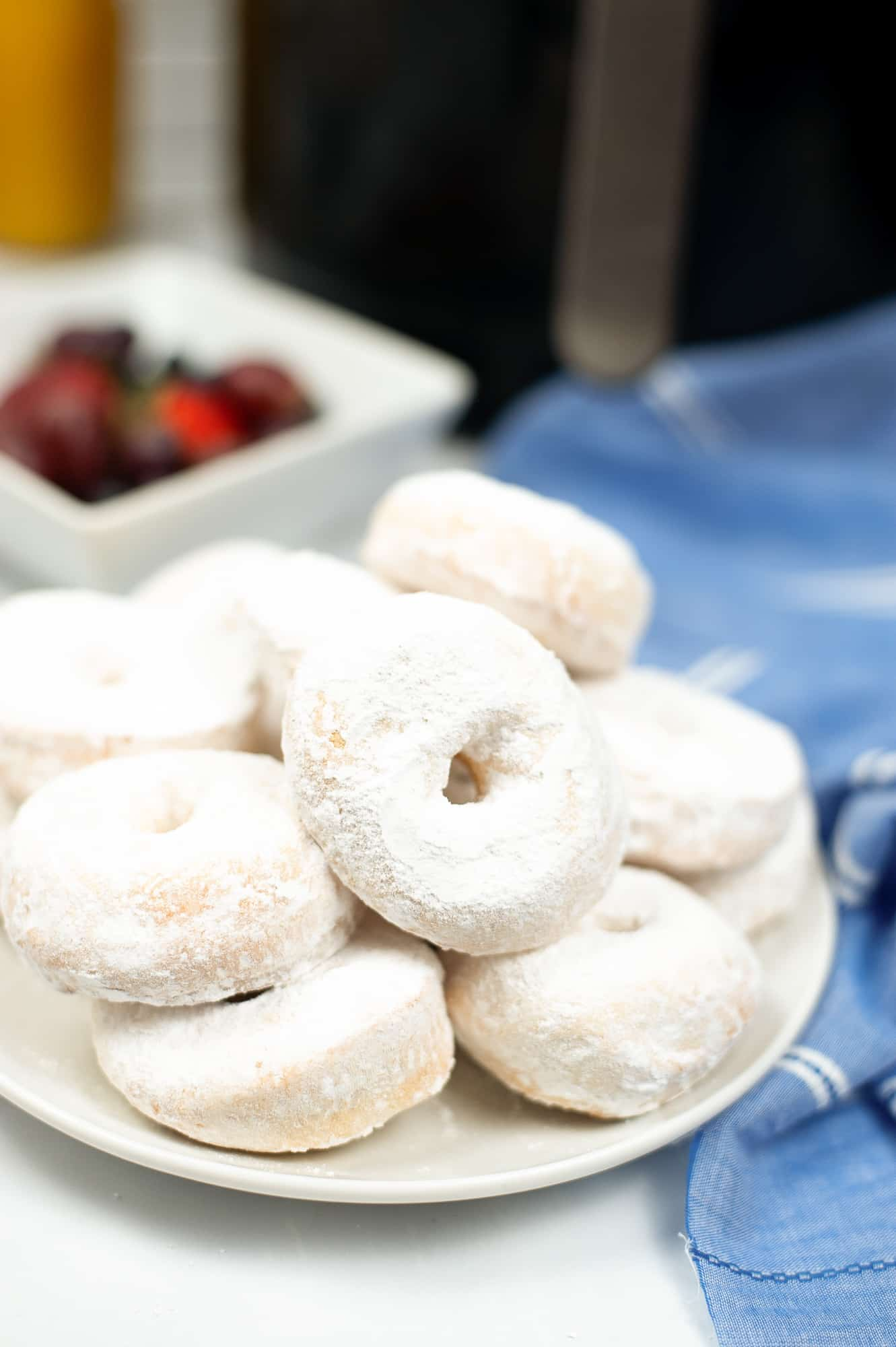 air fryer donuts with powdered sugar on them