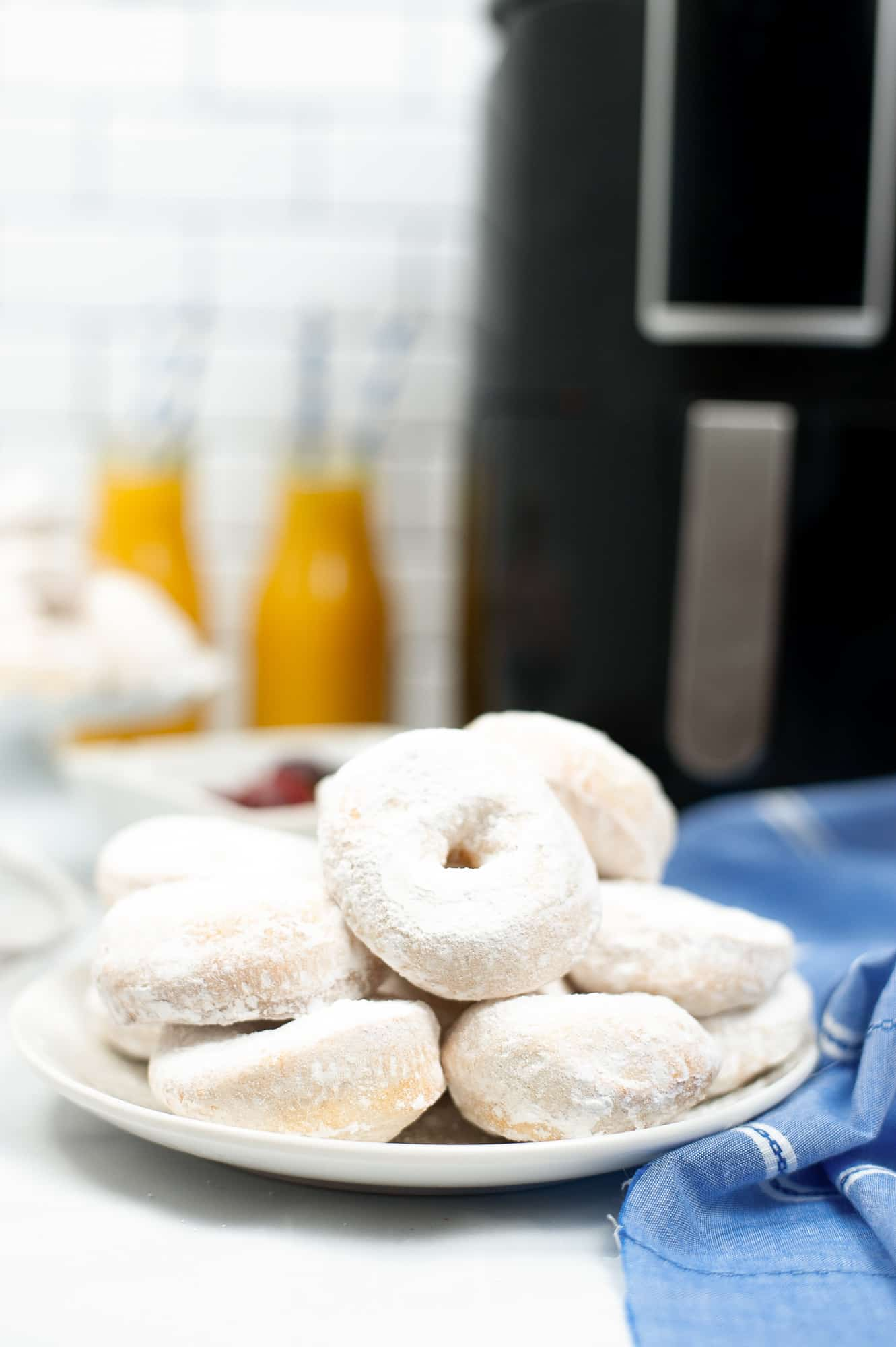 powdered biscuit donuts on a plate