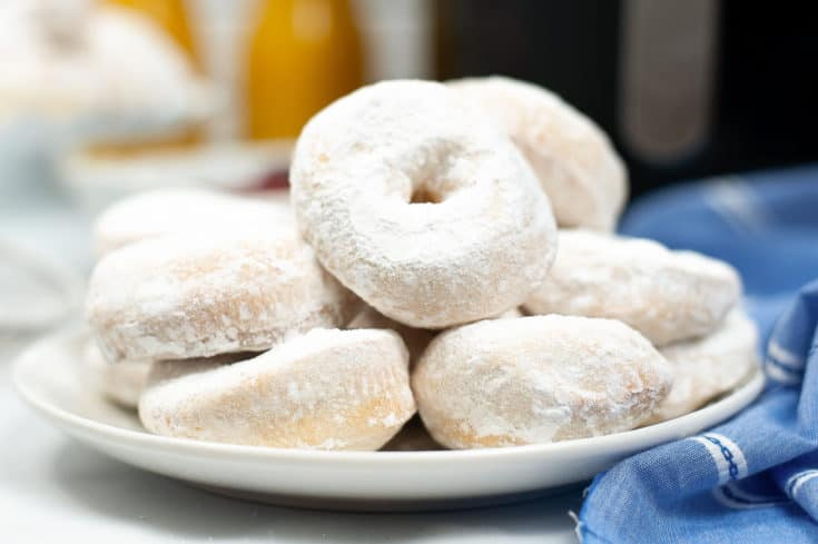 powdered doughnuts on plate