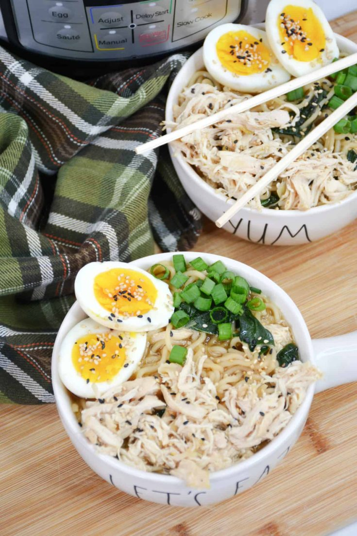 two bowls of ramen with green onions and soft boiled eggs
